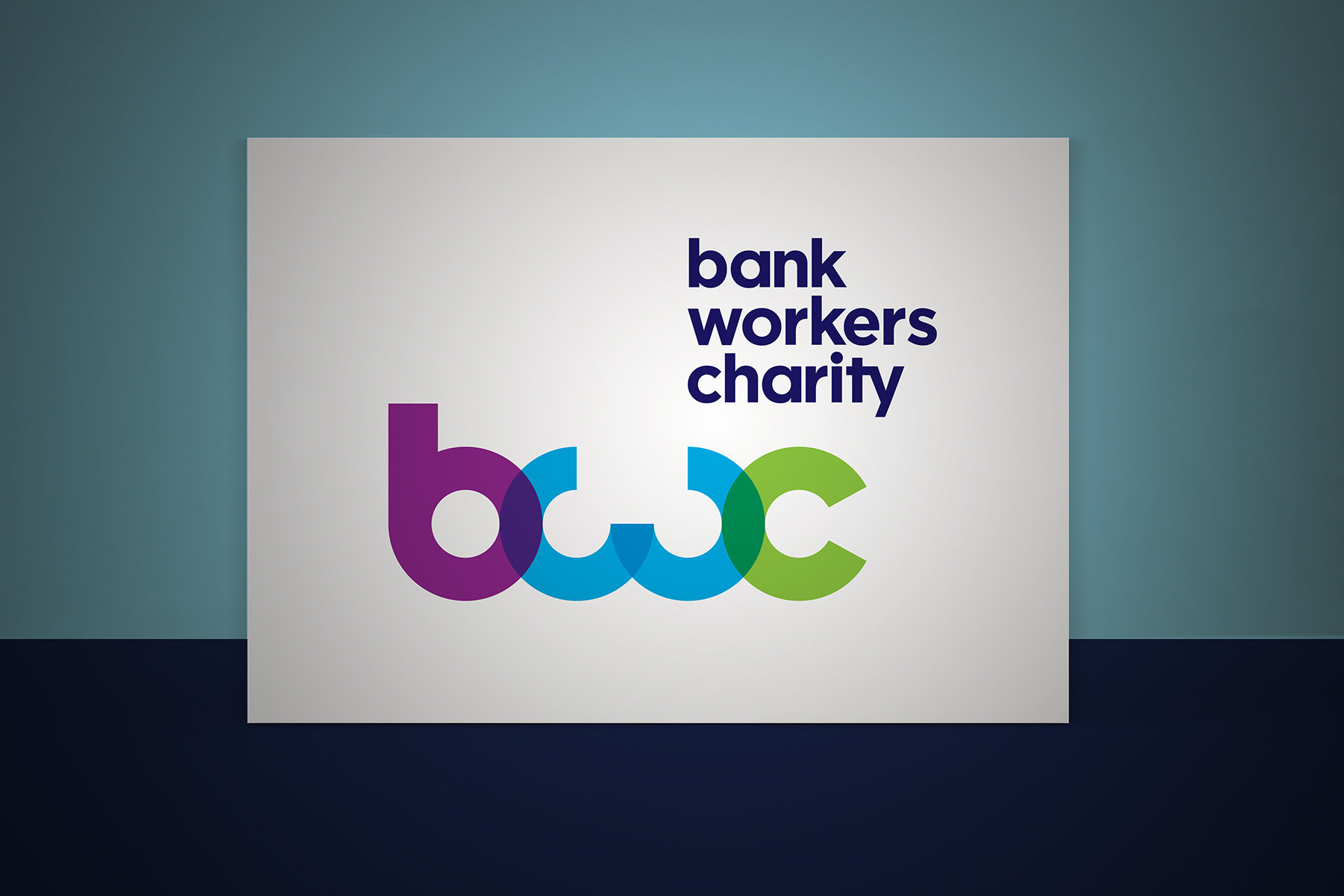 The Bank Workers Charity brand mark is constructed purely out of circular shapes. The transparency and colour creates a modern yet approachable feel.