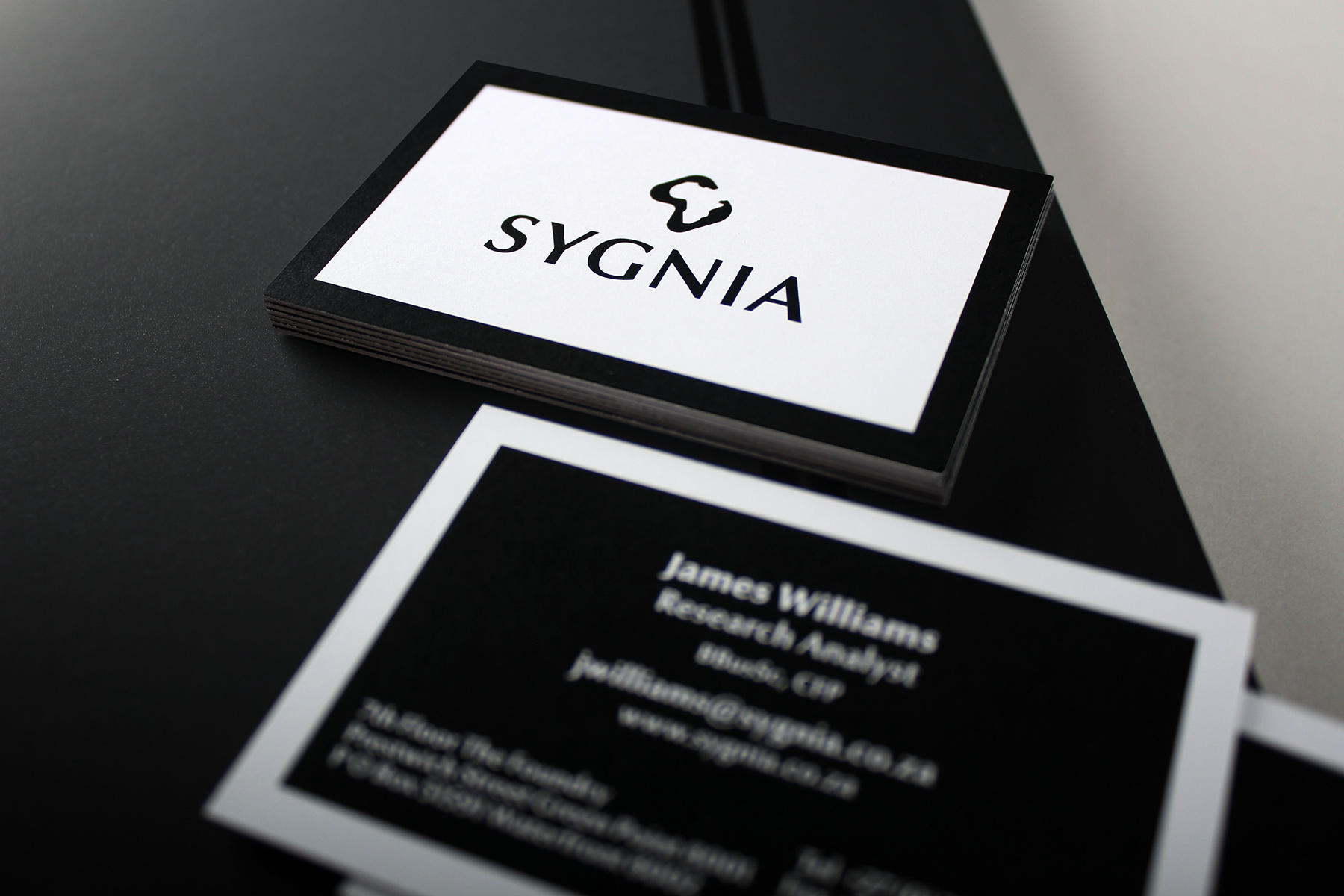 At a high level, the corporate identity reverts to a more minimal feel, with an emphasis on quality print and materials.