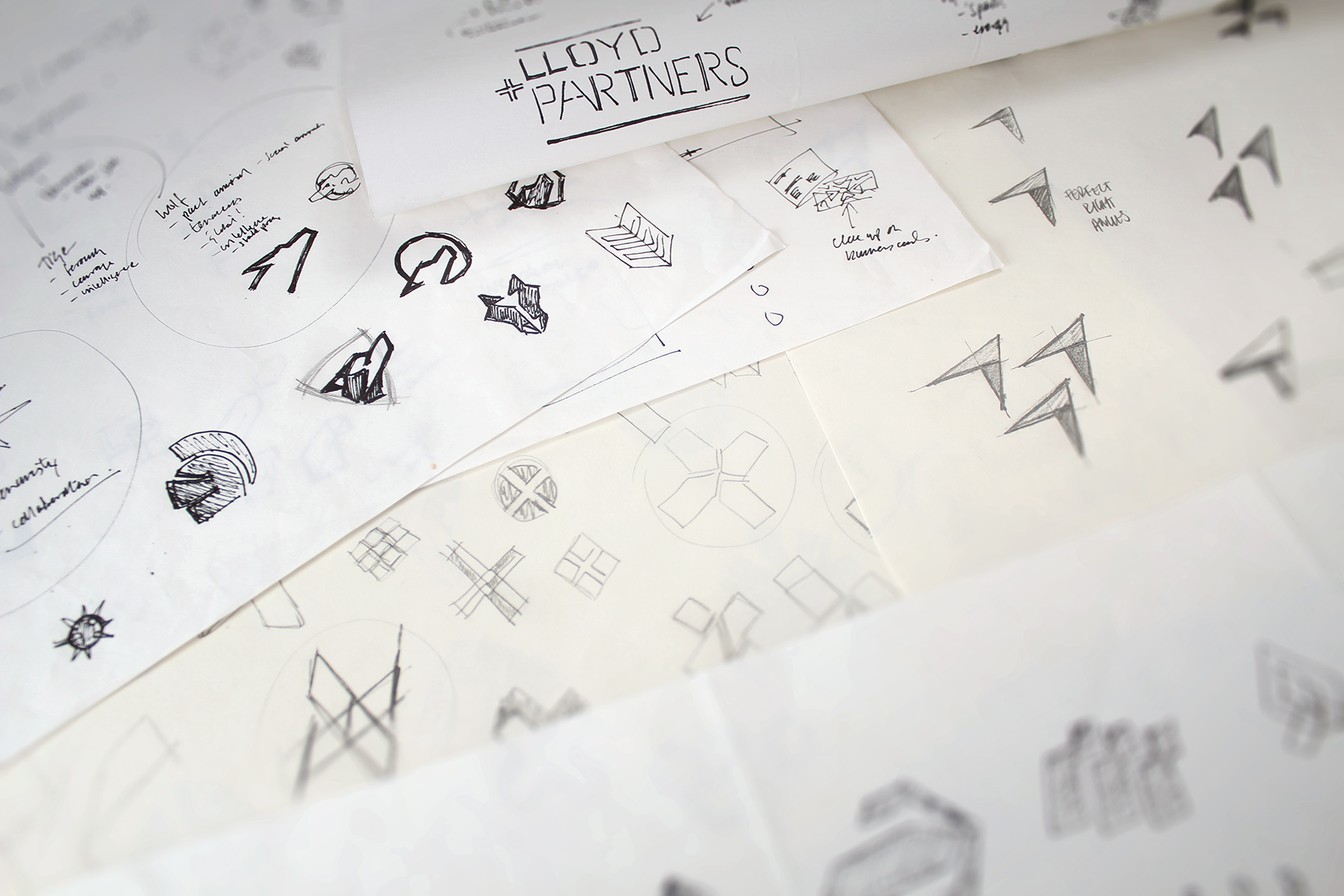 A number of initial routes were sketched out, some focusing on a symbol and others purely on a typographic word mark; all of which could later be further developed
